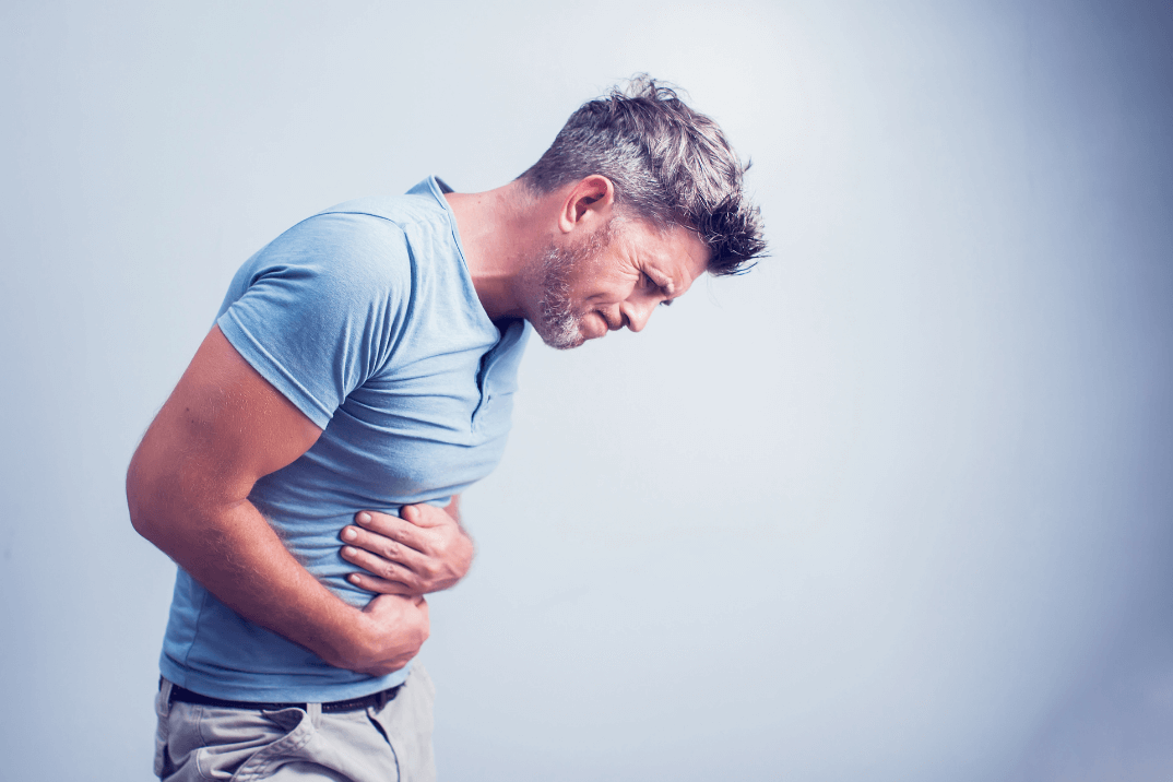 man in pain with upset stomach