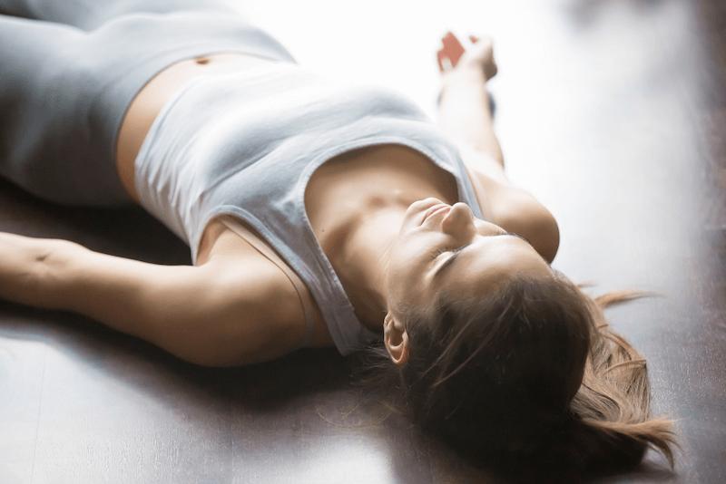 woman laying on the floor yoga nidra