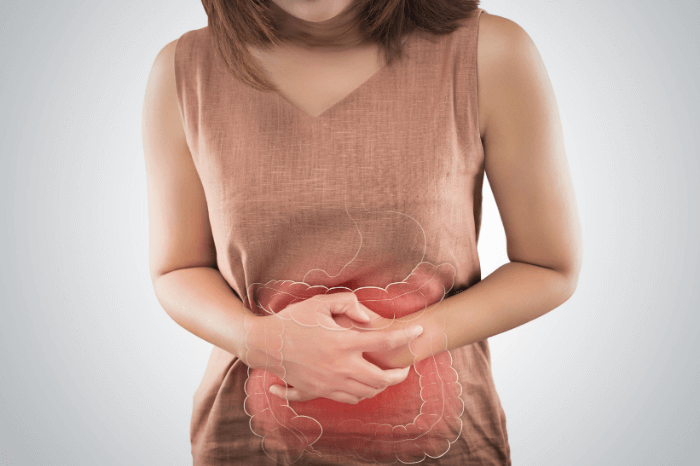 woman clutching stomach in pain with outline of digestive organs on white background