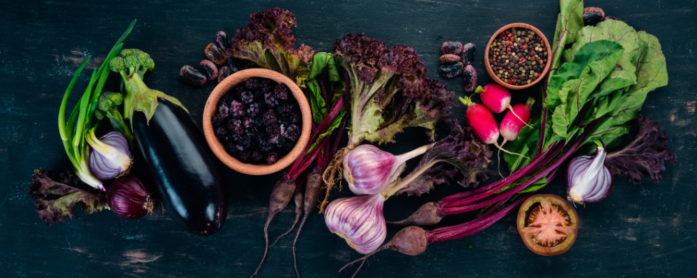 purple vegetables on dark background