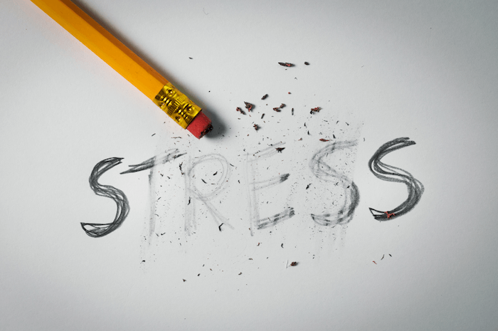 the word stress written in pencil and half erased