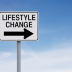 street sign that says lifestyle change with an arrow pointing to the right with the sky in background